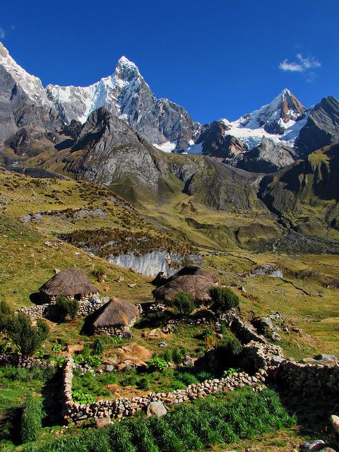 A hamlet of houses in front of Jirishanca, Huayhuash Trek, Peru